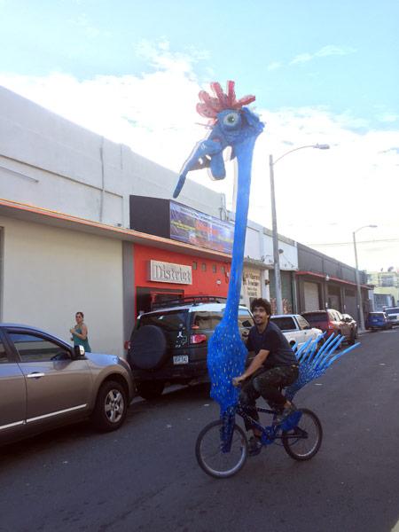 Poncili Creación's Efrain del Hierro rides one of the pieces of the exhibition